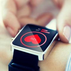 Smart watch with heart icon on screen