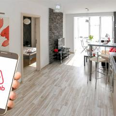 holiday accommodation with a hand holding a mobile phone with Airbnb app